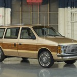 The original Dodge Caravan, complete with fake wire wheel covers and wood grain on the sides
